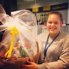 A gift basket I created for a promotion and the happy winner. Also named the best display and gift basket of all stores nationwide.